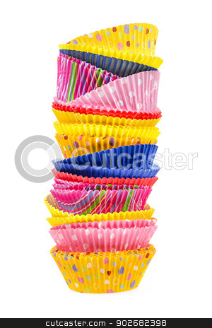Muffin cups stock photo, Stacked colorful muffin cups isolated on white background by Elena Elisseeva