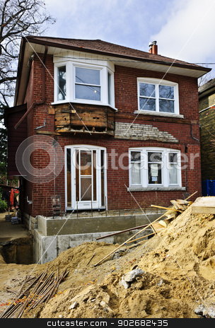 Home renovation exterior stock photo, Exterior of a house under renovation at construction site by Elena Elisseeva