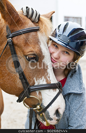 Girl with horse stock photo, Portrait of young woman rider with brown horse by Elena Elisseeva
