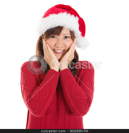 Joyful Asian Christmas woman stock photo, Joyful Asian Christmas woman wearing santa hat. Christmas woman portrait of a cute, beautiful smiling Asian Chinese / Japanese model. Isolated on white background. by szefei