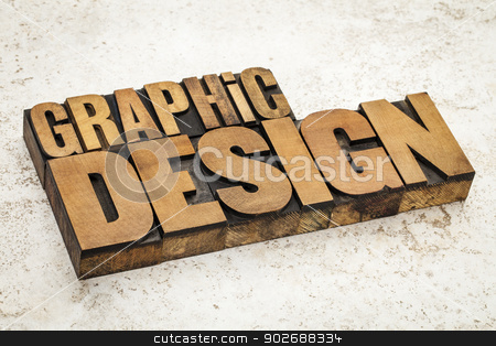 graphic design in wood type stock photo, graphic design  text in vintage letterpress wood type on a ceramic tile background by Marek Uliasz