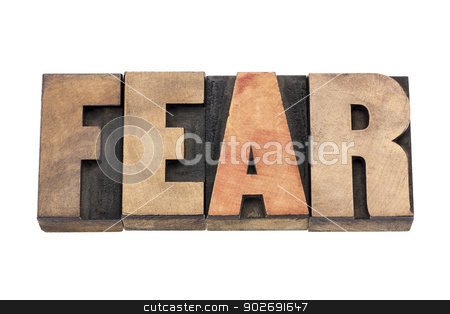 fear word in wood type stock photo, fear word isolated text in vintage letterpress wood type by Marek Uliasz
