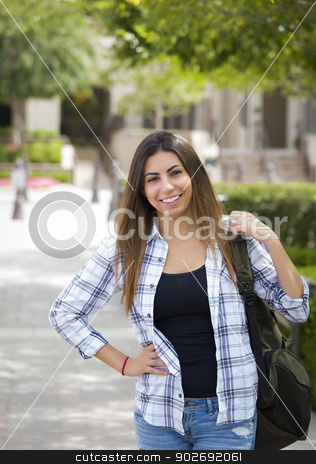 Mixed Race Female Student on School Campus stock photo, Attractive Young Mixed Race Female Student Portrait on School Campus with Backpack. by Andy Dean