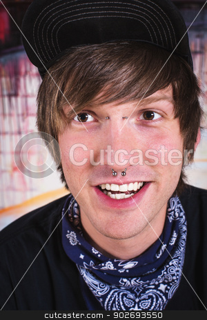 Cheerful Man with Nose Ring stock photo, Laughing man with bandanna around neck and nose ring by Scott Griessel