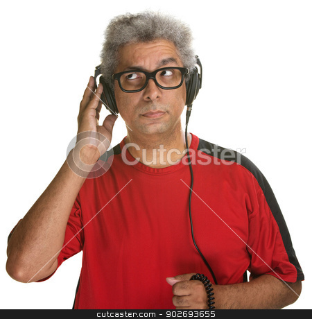 Curious Man Listening stock photo, Handsome mature man listening with headphones on white background by Scott Griessel