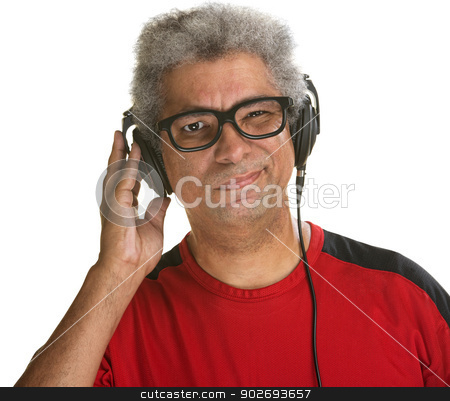 Squinting Man with Headphones stock photo, Handsome mature African man squinting with headphones by Scott Griessel