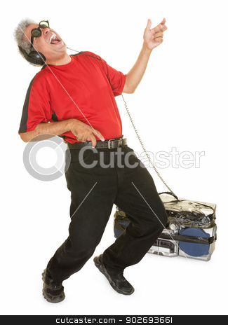 Happy Man Playing Air Guitar stock photo, Happy man with big tape deck playing air guitar by Scott Griessel