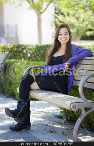 Mixed Race Female Student Portrait on School Campus stock photo, Happy Mixed Race Female Student Portrait on School Campus Bench. by Andy Dean
