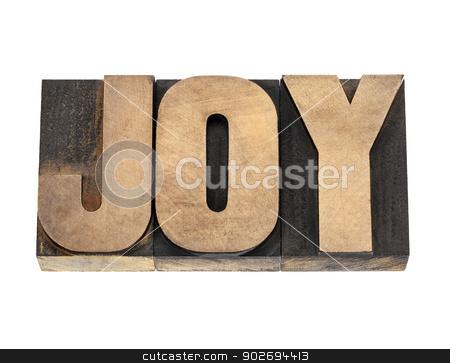 joy word in wood type stock photo, joy word  - isolated text in vintage letterpress wood type by Marek Uliasz