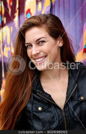 Portrait of a young woman stock photo, Portrait of a young woman infront of a colorful wall. by Henrik Lehnerer