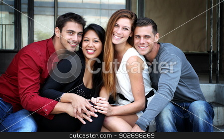 Group of friend stock photo, Group of friend sitting together on stairs. by Henrik Lehnerer
