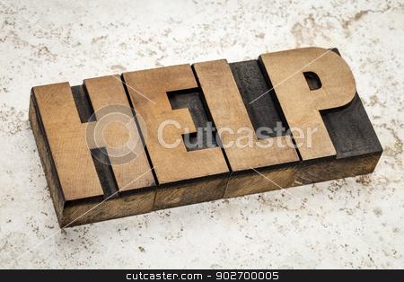 help word  in wood type stock photo, help word   in vintage letterpress wood type on a ceramic tile background by Marek Uliasz