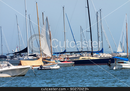 Catboat Sailing Through the Fleet Padnaram Harbor with Boats Dar stock photo, Catboat Sailing Through the Fleet Padnaram Harbor Boats Sailboats, Moorings, Motor Boats, Buzzards Bay Dartmouth Masschusetts     by William Perry