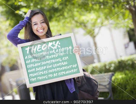Mixed Race Female Student Holding Chalkboard With Theory and Def stock photo, Excited Mixed Race Female Student Holding Chalkboard With Thoery and the Definition Written on it. by Andy Dean