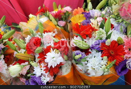 Bouquets of colorful flowers stock photo, Bouquets of colorful flowers on market stall. by Martin Crowdy