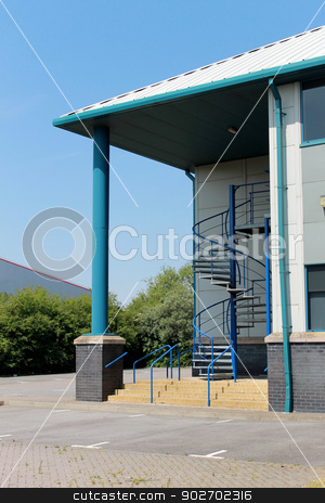 Entrance of modern office building stock photo, Entrance to modern office building with spiral staircase. by Martin Crowdy