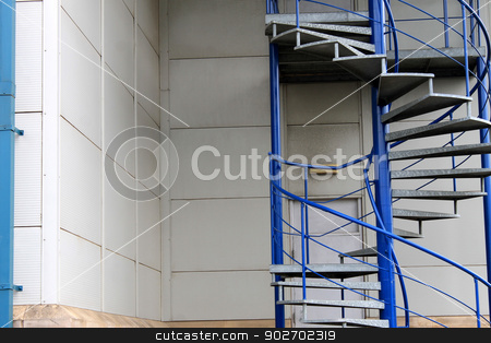 Exterior spiral staircase stock photo, Exterior of spiral emergency exit staircase on modern building. by Martin Crowdy