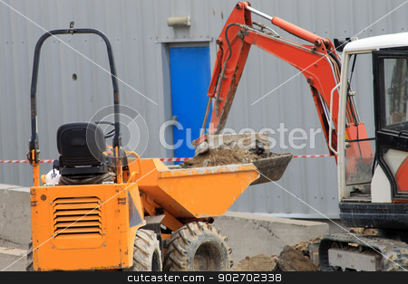 Heavy plant machinery stock photo, Heavy plant machinery and digger on construction site. by Martin Crowdy