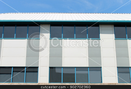 Modern office building stock photo, Exterior of modern office building with windows. by Martin Crowdy