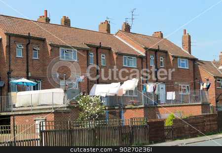 Modern terrace houses stock photo, Rear view of modern terrace houses with washing drying in back yard. by Martin Crowdy