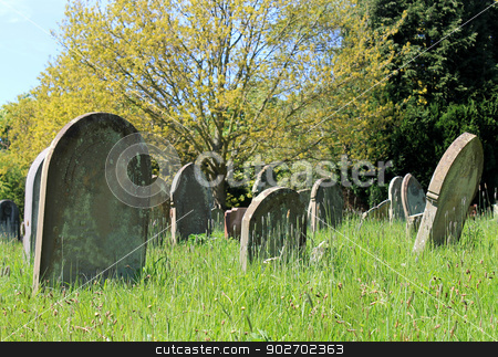 Old graves in cemetery stock photo, Scenic view of old graves in cemetery. by Martin Crowdy