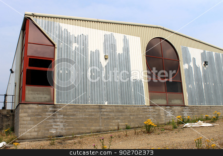 Rundown commercial building stock photo, Exterior of rundown commercial building with sky background. by Martin Crowdy