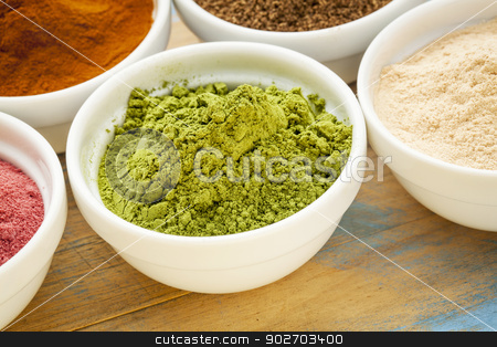 moringa leaf powder stock photo, moringa leaf powder in a small bowl among other super fruit powders by Marek Uliasz