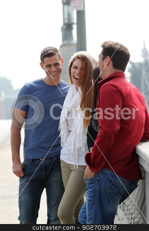 Friends Talking stock photo, Four friends standing together and talking. by Henrik Lehnerer