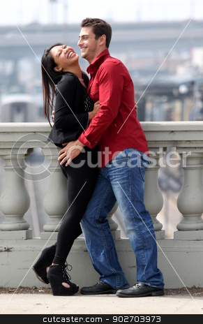 Couple Laughing stock photo, A Couple standing together and laughing. by Henrik Lehnerer