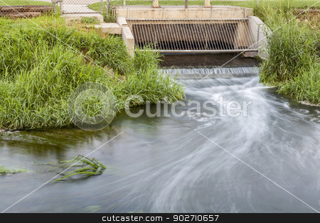 cleaned sewage flowing stock photo, Processed and cleaned sewage flowing out from water reclamation facility to a river by Marek Uliasz