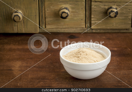 baobab fruit powder stock photo, baobab fruit powder in a small bowl with a rustic drawer cabinet by Marek Uliasz