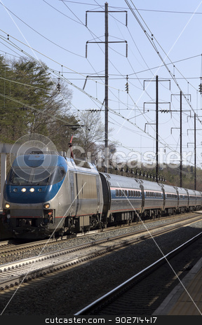 Electric Train stock photo, An electric train pulling into a station on rail road tracks by Kevin Tietz