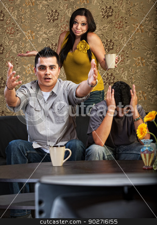 Hispanic Family Watching TV stock photo, Frustrated Latino family indoors in front of television together by Scott Griessel