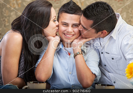 Parents Kissing Son stock photo, Ticklish male child kissed by mother and father by Scott Griessel