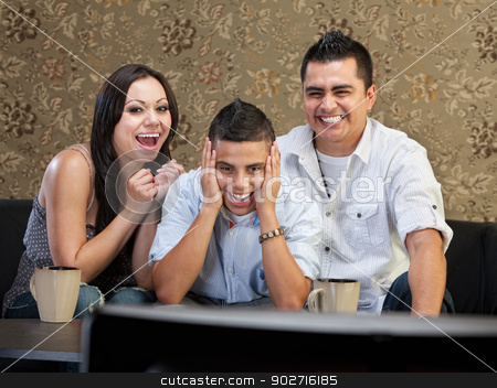 Family Laughing at TV stock photo, Happy family of three laughing at a television by Scott Griessel