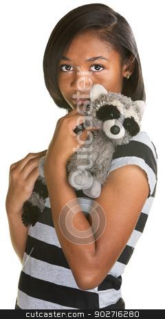 Sad Teen with Toy stock photo, Sad Hispanic teenage girl holding plush raccoon doll by Scott Griessel