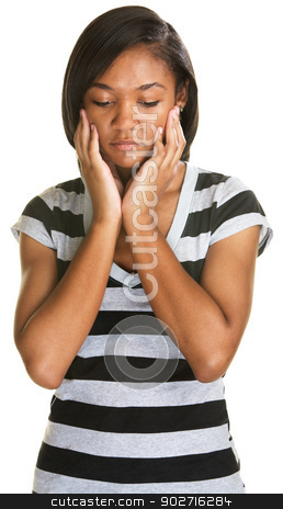 Sad Teen Looking Down stock photo, Sad teenager holding her face and looking down by Scott Griessel