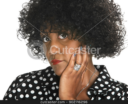 Overwhelmed Black Woman stock photo, Sulky mature woman in polka dots with hand on cheek by Scott Griessel