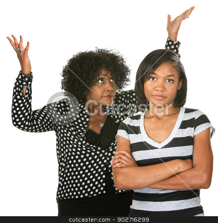 Annoyed Parent with Child stock photo, Hopeless mother with annoyed teenage female child by Scott Griessel