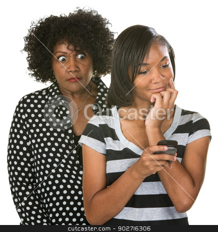 Overprotective Mother with Teen stock photo, Overprotective mother with teenage daughter reading text messages by Scott Griessel