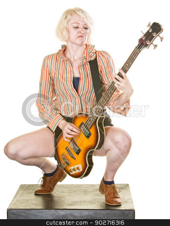 Serious Guitarist stock photo, Serious female electric guitarist on white background by Scott Griessel