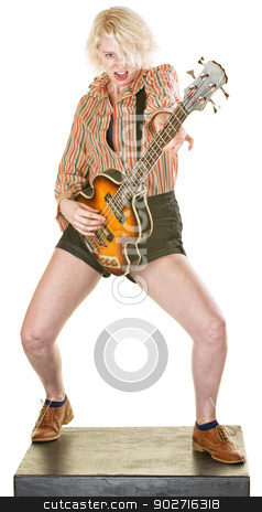 Excited Guitarist stock photo, Excited young woman guitar player on isolated background by Scott Griessel