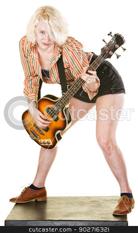 Dancing Guitarist stock photo, Happy young woman playing guitar and dancing by Scott Griessel