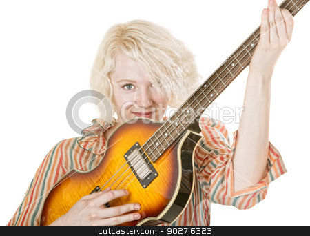 Grinning Female Guitarist stock photo, Grinning young lady electric guitarist on isolated background by Scott Griessel