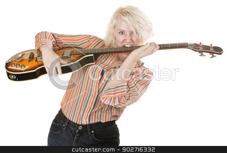 Guitarist Plays with Teeth stock photo, Beautiful electric guitarist playing with her teeth by Scott Griessel