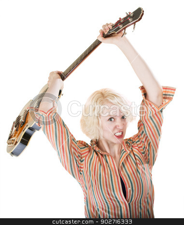 Lady Throwing a Guitar stock photo, Lady with clenched teeth readies to throw a guitar by Scott Griessel
