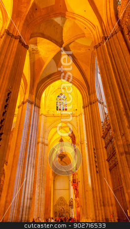 Arch Stained Glass Statues Parisioners Cathedral of Saint Mary o stock photo, Arch Stained Glass Parisioners Seville Cathedral, Cathedral of Saint Mary of the See, Seville, Andalusia Spain.  Built in the 1500s.  Largest Gothic Cathedral in the World and Third Largest Church in the World.  Burial Place of Christopher Columbus. by William Perry