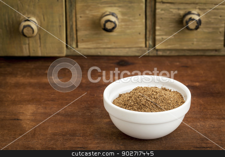 noni fruit powder stock photo, noni fruit powder  from Hawaiian evergreen shrub in a small bowl with a rustic drawer cabinet by Marek Uliasz