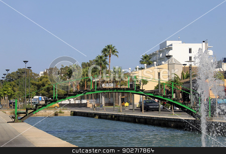 Canal in Alcudia old town stock photo, Scenic view of canal and water fountain in Alcudia old town, Majorca, Spain. by Martin Crowdy