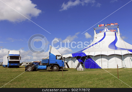 Circus big top tent stock photo, Circus big top tent and trucks in field. by Martin Crowdy